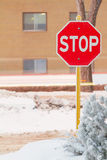 Stop sign. Stop road sign in snowy day in winter. Canada Royalty Free Stock Photo