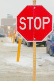 Stop sign. Stop road sign in snowy day in winter. Canada Royalty Free Stock Photos