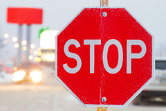 Stop sign. Stop road sign in snowy day in winter. Canada Royalty Free Stock Image