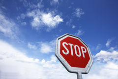 Stop Sign. Traffic sign in front of partly cloudy, partly blue sky Stock Images