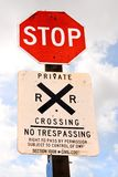 Stop sign. A stopsign together with a railroad warning communicates to passerbys that it is unsafe and illegal to trespass on private property royalty free stock photos