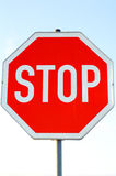 Stop sign. Isolated on a natural light blue background as a vertical image stock photo