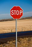 Stop Sign. A stop sign shot on prairie land on a bright, sunny morning royalty free stock images