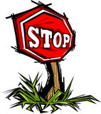 Stop Sign. With Grass and Wood Post Royalty Free Stock Photography