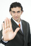 Stop sign. Businessman's hand making a stop sign royalty free stock images