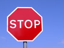 Stop sign. Red stop sign on blue sky background stock image