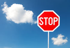 Stop sign against blue sky Royalty Free Stock Photography