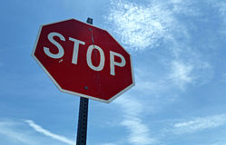 Stop!. Stop sign against a blue sky Stock Photos
