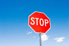 Stop sign against blue sky Stock Images
