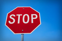 Stop sign against a blue sky Royalty Free Stock Photography