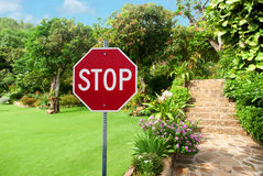 Stop sign against Natural stone landscaping Stock Images