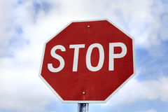 Stop sign against sky Stock Images