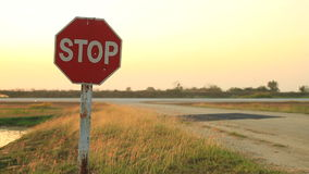 Stop sign at an airfield stock video
