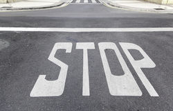 Stop sign on asphalt Royalty Free Stock Photo
