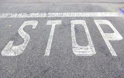Stop sign on asphalt Royalty Free Stock Photos
