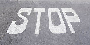 Stop sign on asphalt Stock Photos