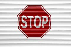 Stop Sign On The Automatic  Aluminum Garage Gate Stock Image