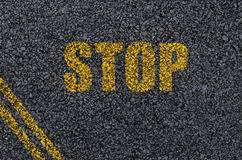 Stop sign background on asphalt with centre lines Stock Images