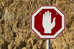 Stopping Rocks. Stop sign on the background of a desert mountain Stock Photo