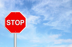 Stop sign with blue sky Stock Images