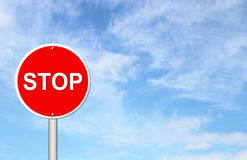 Stop sign with blue sky Royalty Free Stock Photo