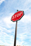 Stop sign on blue sky. Stop sign on a blue sky from below stock image