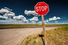 Stop sign on empty highway in Wyoming Stock Photography