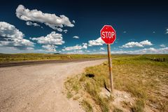 Stop sign on empty highway in Wyoming Stock Image