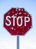 Stop Sign With Bullet Holes Royalty Free Stock Photography
