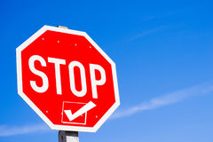 Stop Sign with Checkbox. Stop sign with checed box concept of stop and check first against blue sky background Stock Images