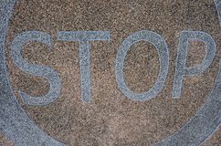 Stop sign in the circle on marble floor skin. White warning sign to stop in the circle on marble floor skin Stock Image
