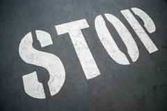 Stop sign on city asphalt floor Stock Image