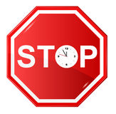 Stop sign with clock Royalty Free Stock Photo
