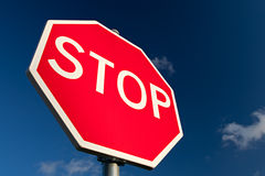 Stop Sign Close Up. Stop sign against deep blue sky. Close up royalty free stock image