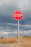 Stop sign, cloudy sky Stock Image