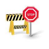 Stop sign and construction barrier isolated on white Stock Images