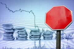Stop sign with copy space on economy background. Business and finance concept. Template for money, economy