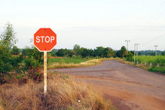 Stop sign in country road Stock Images