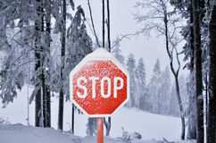 Stop sign covered by snow and frost Stock Photo
