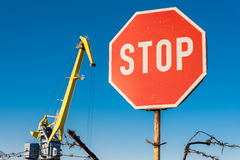 Stop sign. With crane at port Royalty Free Stock Photo