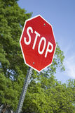 Stop Sign Cropped Diagonally in a Vertical Format Stock Image