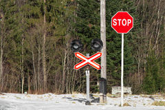 Stop sign with a cross. In front of the old railway crossing royalty free stock images