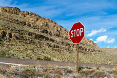 Stop sign in desert. Stop sign on quiet road in Big Bend National Park in West Texas, near the Rio Grande and the border with Mexico Stock Photography