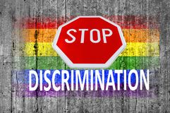 STOP sign and discrimination and LGBT flag painted on background Stock Photo