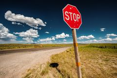Stop sign on empty highway in Wyoming Stock Images