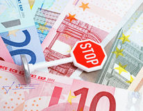Stop sign and Euro currency Royalty Free Stock Photos