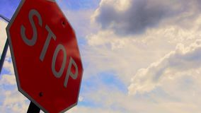 Stop sign with fast moving clouds stock footage