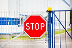 Stop sign on fence Stock Photography