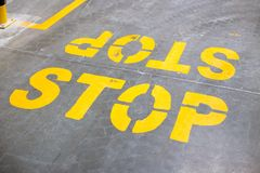 Stop sign on the floor stock image