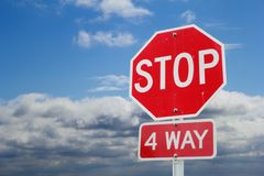 Stop sign in front of clouds Royalty Free Stock Photo